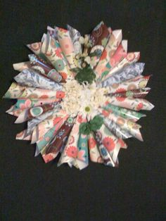 Wreath made from wrapping paper and decorated with flowers