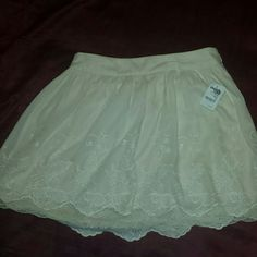 Nude lace skirt Brand new still with tags. Very cute but it doesn't fit me Charlotte Russe Skirts