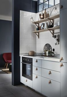 Gravity Home: Small blue kitchen