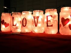 """Love Lanterns"" from old jars. Mod Podge pink tissue paper, add cutouts from red paper, hot glue ribbon at top and insert string lights! Valentine Tree, Valentine Crafts, Valentine Day Gifts, Mason Jar Crafts, Mason Jars, Glass Jars, Holiday Fun, Holiday Crafts, Summer Crafts"