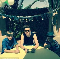 It's all for you: Brooklyn Beckham, pictured with brothers Romeo and Cruz, has issued a personal thank you to his parents after winning his two millionth Instagram follower on his father's 40th birthday