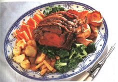 with roasted potatoes, parsnips and carrots and Yorkshire puddings ...