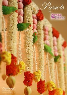 Flower Toran:Parrots symbolise love and togetherness and what better ways to decorate your wedding than using these cute, lovely birds for the decor? They are the most trending props for weddings and we have fo. Desi Wedding Decor, Wedding Stage Decorations, Engagement Decorations, Wedding Mandap, Diwali Decorations, Garland Wedding, Festival Decorations, Flower Decorations, Wedding Flowers