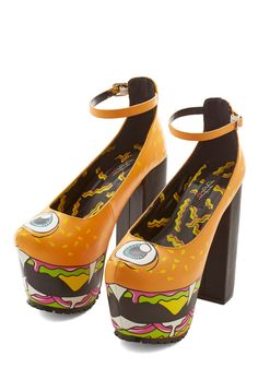 Flying Burger People Eater Heel. It had two big fangs and one big eye - and it came from the sky to lend monstrous charm to these extraordinary heels! #orange #modcloth