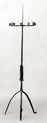 Candelabra    Date:      15th century  Culture:      French or Spanish  Medium:      Iron  Dimensions:      Overall: 60 x 15 in. (152.4 x 38.1 cm)