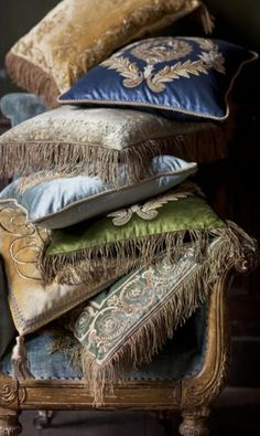 Jade, blue and pale gold hand-embroidered cushions from Beaumont & Fletcher.