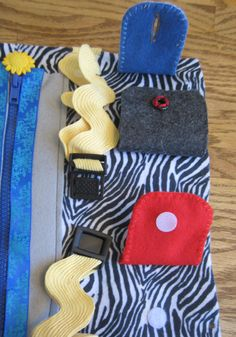 Zipper Snaps Button Velcro Buckle Tie would be a good small motor skills, easy page to make