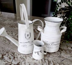 DIY French Cans with us! After buying these decorative cans, she painted them with white chalk paint, added highlights with black paint at the edges