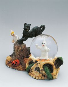 Close-up of figurines with a snow globe