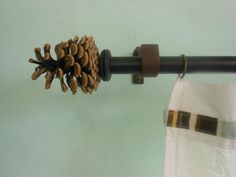 Make Your Own Curtain Rod Finials using pinecones. (What else could I use?)