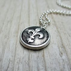 Hey, I found this really awesome Etsy listing at https://www.etsy.com/listing/116516692/silver-fleur-de-lis-necklace-wax-seal