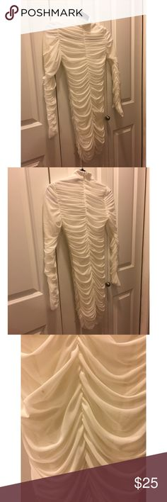 Ivory Scrunched Mini Long Sleeve Dress Re-listed to show spot I missed on the mini; not noticeable at all as the dress is scrunched/ruched. Lined and super cute to accentuate your curves. 11thStreet Dresses Mini