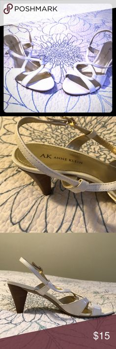 Anne Klein AK Kareem White High Heels Size 8 1/2 White high heels worn one time to a wedding. Made by Anne Klein AK size 8 1/2 M. Inside is a light metallic gold color. Great condition! Comes from a pet free and smoke free home! Anne Klein Shoes Heels