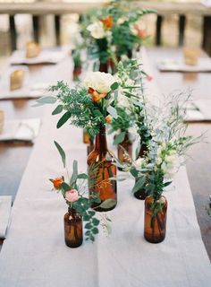 Table decorations ideas with eucalyptus--I could do green or amber bottles with assorted greenery