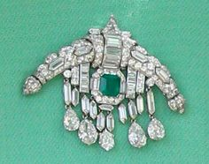 Queen Elizabeth II Art Deco Diamond and Emerald brooch.