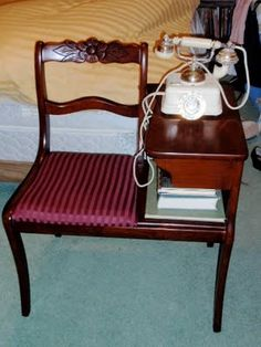 Here is a gossip bench I bought from Black Rose Antique.  It is a Duncan Phyfe piece.  The rotary phone was my grandparents