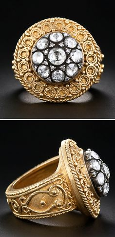 22k Gold and Rose Cut Diamond Ring. A glittering rosette composed of nine larger rose-cut diamonds, punctuated by 16 tiny rose-cut diamonds, all set in oxidized silver, are the center of attraction in this bold and hefty 22 karat gold bauble recently crafted in emulation, and as an update, of nineteenth century Etruscan Revival style jewels. 1.00 carat total diamond weight.