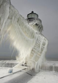 Frozen Lighthouses On Lake Michigan Shore; winter-snow-natural-ice-art-7