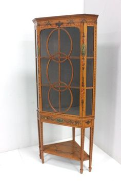 Adams style corner cabinet With mullion doors, early 20thc.