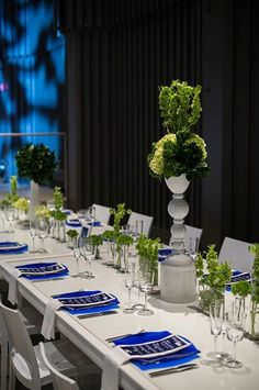 Modern and unique green themed wedding ceremony tablescape with royal blue accents. Image courtesy of Studio Nouveau www.thestudionouveau.com.  Floral Design by Karla Cassidy Designs http://www.karlacassidydesigns.com