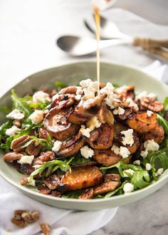 Roasted Sweet Potato Salad - with arugula/rocket, pecans, goats cheese or feta, a sprinkle of bacon and a beautiful Honey Lemon dressing. www.recipetineats.com