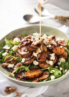 Roasted Sweet Potato Salad - with arugula/rocket, pecans, goats cheese or feta, a sprinkle of bacon and a beautiful Honey Lemon dressing. www.recipetineats.com