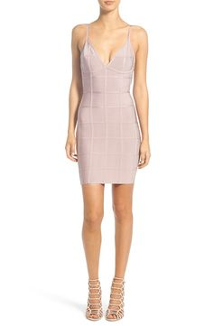 Ideal for girls' night out, this curve-hugging bandage dress is eye-catching when paired with nude heels.