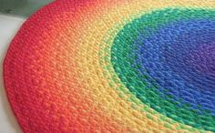 A whole host of amazingly lovely rugs, with gradient and rainbow standouts. Organic rainbow rug braided from USA Organic fabric and some recycled t shirts. Via Etsy. Tee Shirt Rug, T Shirt Yarn, T Shirt Diy, Tee Shirts, Hula Hoop Rug, Hula Hoop Weaving, Fabric Weaving, Fabric Yarn, Cotton Fabric