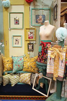 booth display from funky vintage lovely. Great way to sell frames, pillows, and aprons.