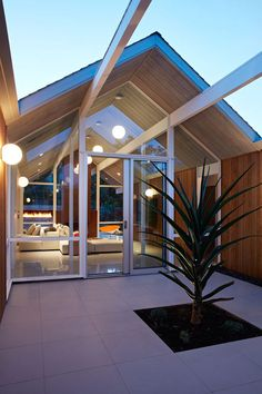 This remodeled mid century modern house in California has a courtyard before you reach the main living area.