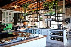 The shaker style cabinets and metal rails that are basically a dream kitchen at The Grounds of Alexandria in Sydney. 31 Coffeeshops And Cafés You Wish You Lived In Cafe Bar, Cafe Restaurant, Restaurant Design, Organic Restaurant, Coffee Shop Design, Cafe Design, The Grounds Of Alexandria, Alexandria Sydney, Shaker Style Cabinets