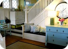 Built in bench at bottom of stairs.  And lots of painted dressers!