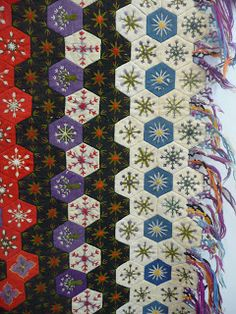 not so zen-quilts in Paris: The Michel Perrier collection. Loving the embroidery in these hexies!