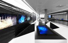 """""""The Boss'"""" Office - Etteos' space is sleek and modern, featuring the best that his money can buy in the form of technology; while he is behind Lukofos' homemade machines, Etteos' space reflects his artificial nature."""