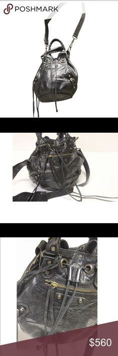 """W E E K E N D  S A L E Authentic Balenciaga bucket Weekend sale 25% off of asking price!!! Balenciaga  ( authentic) black wrinkled lambskin Arena Classic bucket bag. Tassel-trimmed zip pocket and metal nickel buckles and studs at front, aged brass tone and pewtertone hardware. Lined with black fabric; zip pocket at interior. Whipstiched rolled leather top handles; detachable, adjustable flat leather shoulder strap with shoulder rest. Drawstring closure at the top. 10"""" H x 7"""" W x 7"""" D, approx…"""