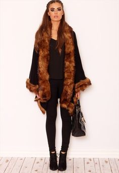 "Lavish yourself in this thick luxurious faux fur trim poncho this season. The premiuim feel and waterfall style fit is bang on trend this AW14 and here at lullabellz we can't get enough of this peice. There's no need to wear a coat when you have one of these beauties in your wardrobe wear it with a pair of black skinnies and ankle boots for that premiuim look. Approx length 82cm/31.4"" (Based on a UK size S sample)  35% Polyester 65% Cotton  Model wears a UK size S and her height is 5ft ..."