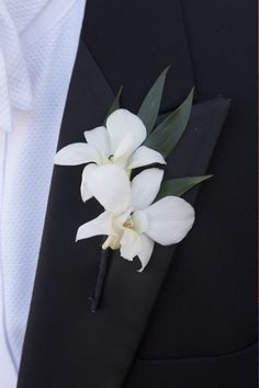 I love boutonnières. Done right, they are a spark of color to brighten a stunning masculine look; a bit of the peacock on a classic structured suit. So for Flower Friday I went looking for wonderfu...