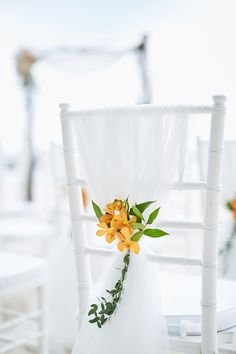 The orange orchids really stand out against the chiffon on our tiffany chairs Destination Wedding Planner, Wedding Planning, Tiffany Chair, Orange Orchid, Wedding Chairs, Unique Weddings, Ladder Decor, Orchids, Chiffon