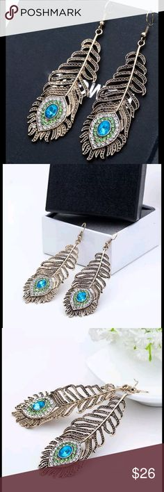 """Peacock feather Rhinestone dangle earrings Antiqued Gold Hook Dangle Earrings, with sparkly clear,green and turquoise  rhinestones  Great detail and beautiful unique styling   Size: 2.76"""" x 0.98""""   New with tags Boutique Jewelry Earrings"""