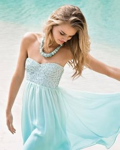 Sea colored dress.