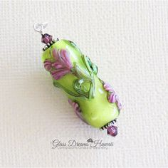Handmade Lampwork Glass Bead Pendant, Pastel Green and Pink Floral... ($40) ❤ liked on Polyvore featuring jewelry, pendants, glassdreamshawaii, glass jewelry, pink jewelry, floral pendant, sterling silver pendants and green pendant