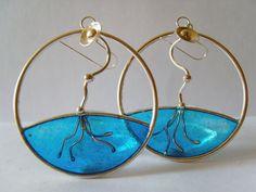 "Silver Resin Earring ""Pies bajo el agua"". €85.00, via Etsy."
