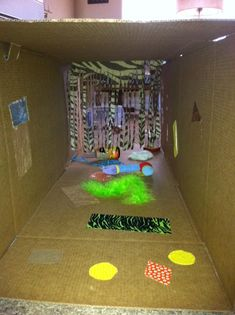 Sensory tunnel for infants. Two boxes taped together plus whatever you have on hand. I had sandpaper, feather boa, ribbon, rabbit fur (hobby lobby), reflective paper, tactile paper, fabrics, etc. Good fun for little movers. Use a hot glue gun through out to also create more tactile experiences.