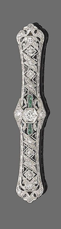 A belle époque synthetic emerald and diamond brooch, circa 1915  The pierced lozenge-shaped plaque, millegrain-set throughout with single and old brilliant-cut diamonds, highlighted with calibré-cut synthetic emeralds, diamonds approx. 0.30ct total, length 6.2cm