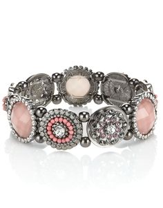 Add a touch of sparkle to your look with this beautiful flower disc bracelet.