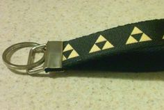 Customized 1 wide key fob/key chain with Legend of Zelda design of your choice! Each Key Fob is made to order with heavy cotton webbing, ribbon and steel hardware. A great gift for the gamer in your life! Please message us for bulk pricing if you need 5 or more!  Choose the pattern and background color using the drop don menus.  Message us with personalization options:  If you want a different color choice for the backgrounds or symbols click on the Request Customization button.  Images ...