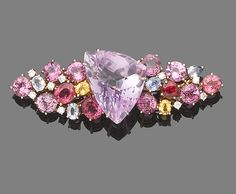 A gem and diamond-set brooch. The centrally-set triangular fancy-cut kunzite, between shoulders set with circular and oval-cut sapphires of various hues and highlighted with brilliant-cut diamonds maker's mark Modern Jewelry, Vintage Jewelry, Gold Brooches, Pearl Color, Gems Jewelry, Crystals Minerals, Gemstone Colors, Pretty In Pink, Pink Purple