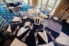 blue tablecloth, white napkins and lantern