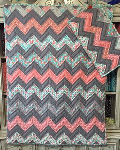Aqua Gray and Coral Chevron Crib Quilt and matching Doll Quilt by ErinLynnDesigns on Etsy https://www.etsy.com/listing/225988735/aqua-gray-and-coral-chevron-crib-quilt