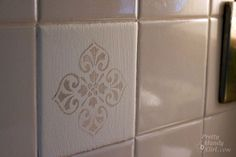 paint over tacky tiles and add a stencil